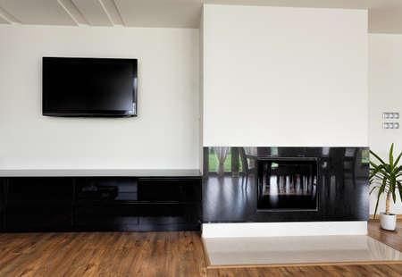 Urban apartment - modern fireplace with stone wall around