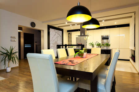 dining room table: Urban apartment - Wooden table in modern dining room Stock Photo
