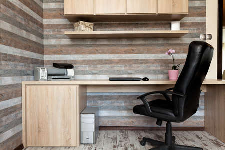 new office space: Urban apartment - modern office with a wooden desk Stock Photo