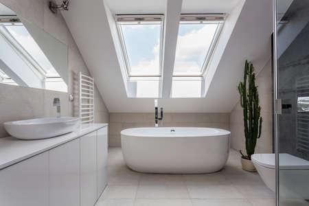 bathroom design: Urban apartment - white bathroom with modern bath