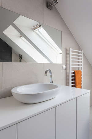 Urban apartment - white round ceramic sink in bathroom photo