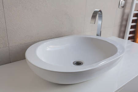 vessel sink: Urban apartment - modern white oval vessel sink Stock Photo