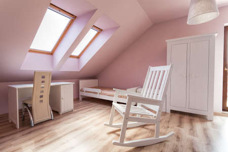 Urban apartment - bright girls room with rocking chair Stock Photo - 21822141