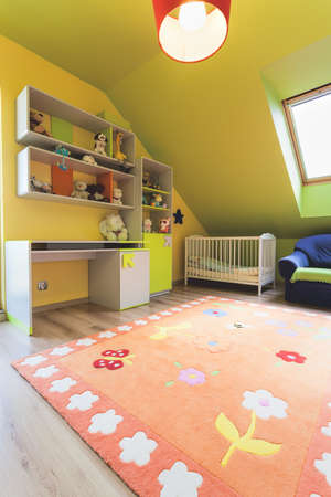 Urban apartment - colorful baby room with wooden crib photo
