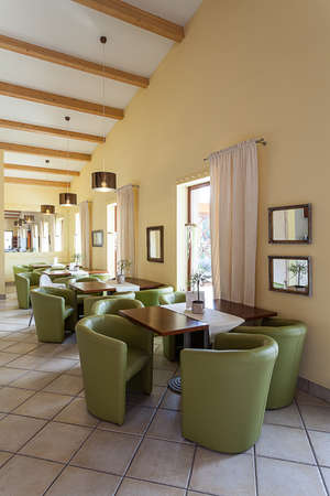 mediterranean interior: Mediterranean interior - a waiting room with tables and armchairs Stock Photo