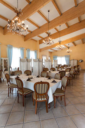 Mediterranean interior - an elegant dining room with chandeliers photo