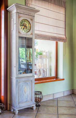 mediterranean interior: Mediterranean interior - a stylish tall antique clock Stock Photo