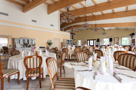 mediterranean interior: Mediterranean interior - classy set tables with striped wooden chairs Stock Photo