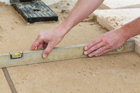 paving stone: Level line on a building site, closeup Stock Photo
