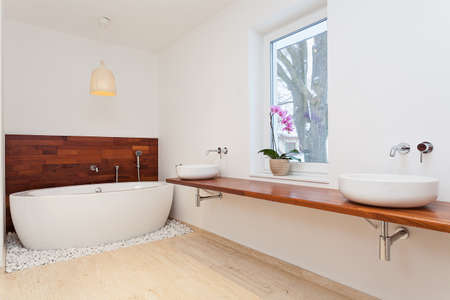 Bright spacious exotic bathroom with big window Stock Photo - 21921144