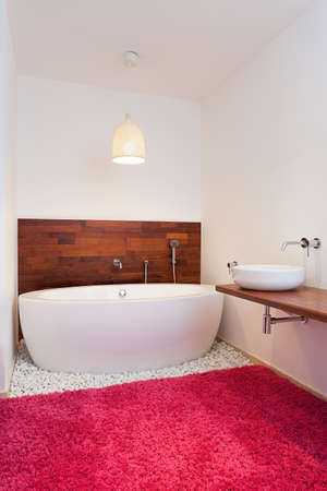Bath in exotic spacious bathroom in exotic style photo