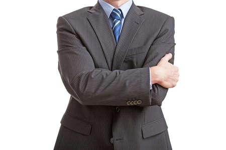 lenguaje corporal: Empresario de pie con una postura cerrada, aislada Foto de archivo