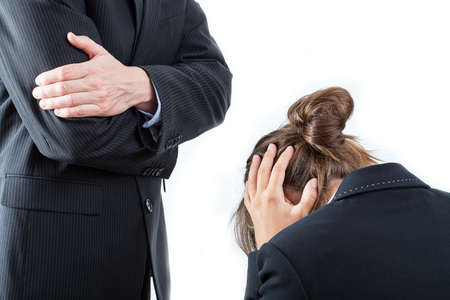 Boze werkgever en de werknemer tegenover hem Stockfoto