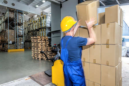 Load of packages doing by a worker in the warehouse