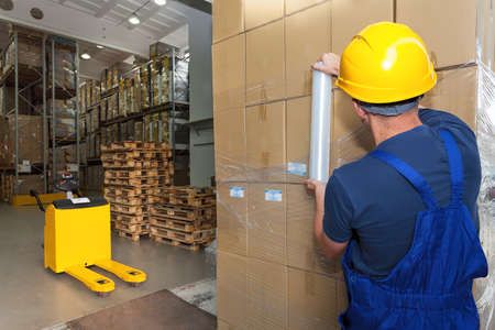 Storage work executing by warehouse worker photo
