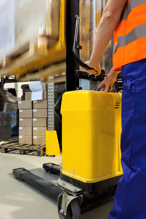 forklift driver: Closeup of a yellow forklift with an operator Stock Photo