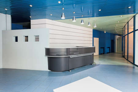 Modern reception in a factory, grey counter photo