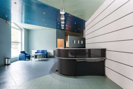 interior office: Blue and grey reception in a hallway of factory