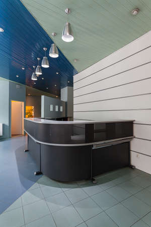 bank interior: Grey modern counter on an entrance to company