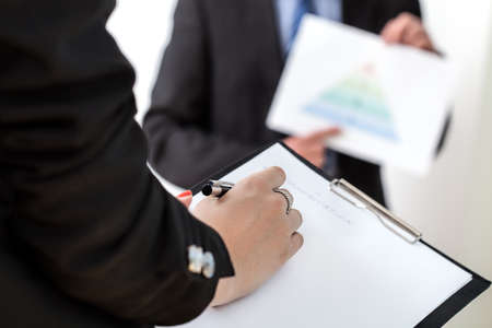 taking notes: Taking notes at a business meeting with manager