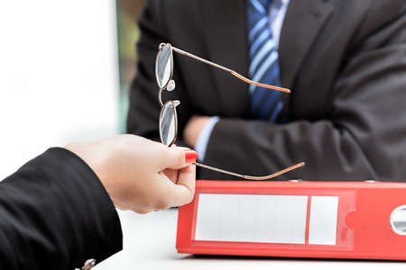 bad planning: Bad news from a boss at the meeting Stock Photo