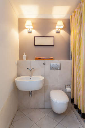 bathroom mirror: Vintage mansion - a small water closet with a sink Editorial