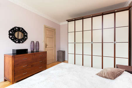 wooden partition: Vintage mansion - a white brown partition wall in a classy bedroom Stock Photo