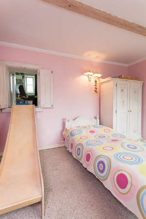 Vintage mansion - a bright room with a wooden slide photo