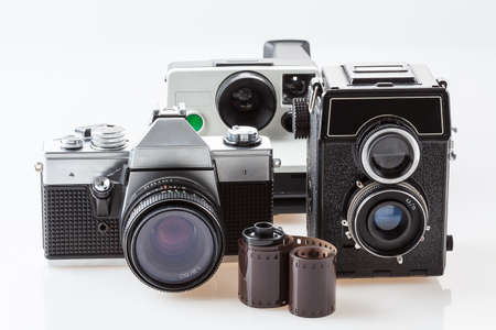 sharpness: Three vintage cameras and a roll of film Stock Photo