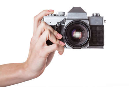 A man holding a reflex camera in his hand photo