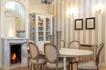 Vintage mansion - a cosy dining room with a fireplace photo