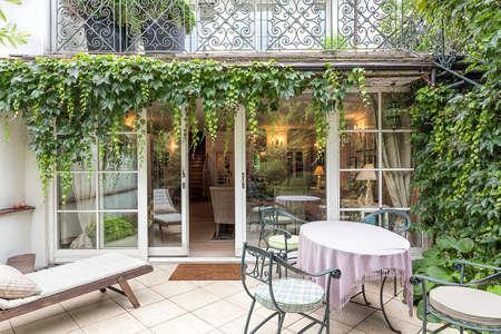 Vintage mansion - a cosy veranda with an ivy Stok Fotoğraf - 22183451