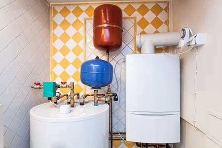 Vintage mansion - a boiler room with containers and pipes Stock Photo