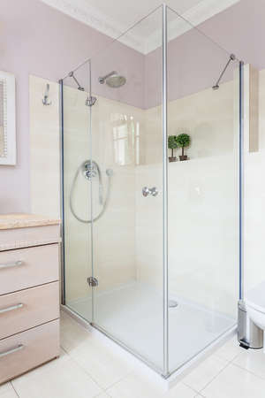 classy house: Vintage mansion - a glass shower in a bright bathroom Stock Photo
