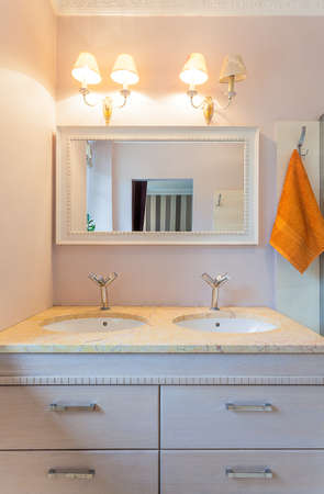 Vintage mansion - elegant sinks under a wihite mirror photo