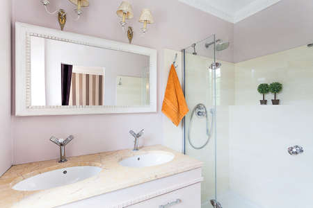 Vintage mansion - a bright rest room with a glass shower and stone sinks photo