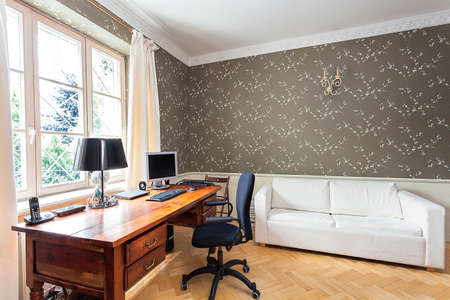 white office: Vintage mansion - office with a wooden desk and a white couch