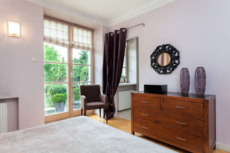 Vintage mansion - a wooden wardrobe and an armchair photo