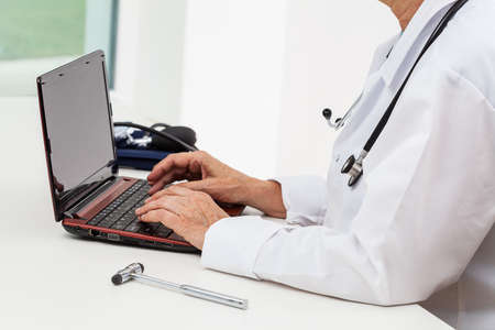 operate: A doctor doing his research on a netbook