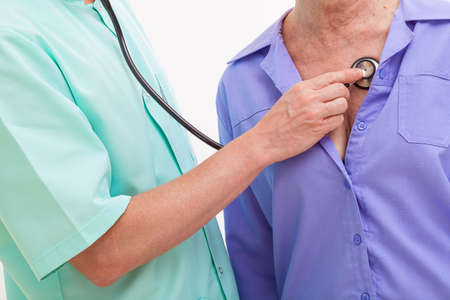 auscultation: Doctor listeninig to a patient with a stethoscope