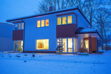 winter scenery: Modern house in winter scenery