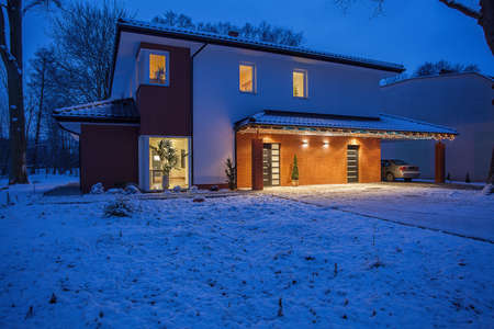 Contemporary house in winter scenery photo
