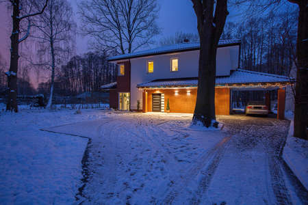 Exterior of gorgeous house in winter scenery photo