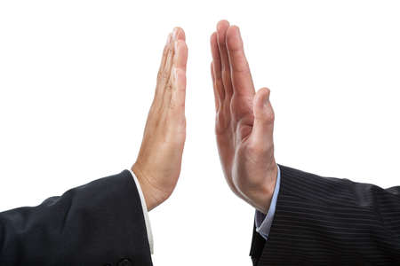 hands high: Closeup of two hand giving five, isolated background Stock Photo
