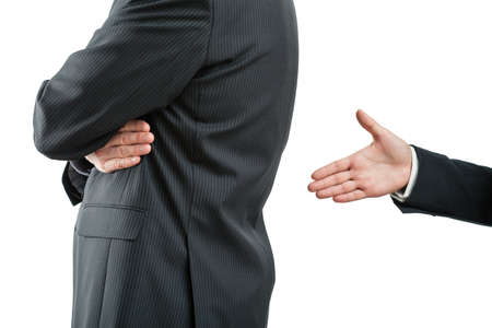 apologise: Hand open to shake because of quarrel between two businessmen Stock Photo