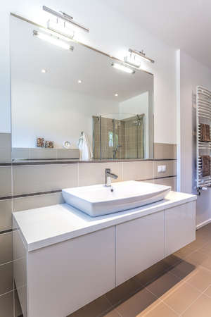 Bright space - a white modern ladies room with a big mirror photo