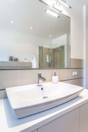 Bright space - a white sink in a modern restroom photo