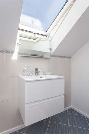 Bright space - a white bathroom shelf with a sink photo