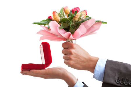Proposal- man holding ring and flowers, isolated background photo