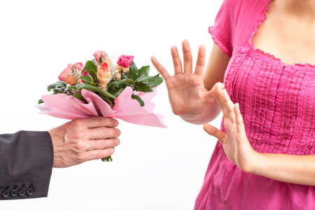 apologise: Angry wife refusing a flowers for apology Stock Photo